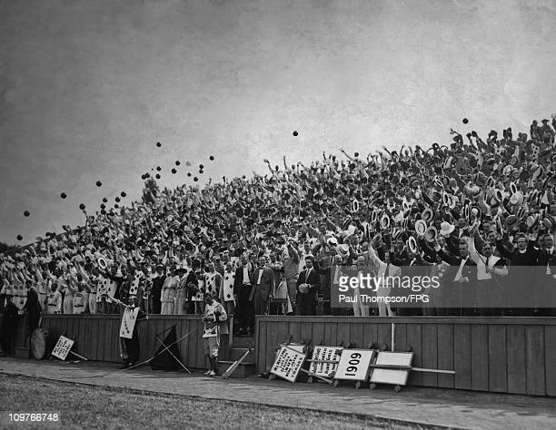 A crowd of men raise their hats at a Princeton University commencement ceremony in 1909