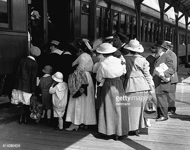 A crowd of mothers with their children board trains traveling out of New York to escape the infantile paralysis epidemic of 1916
