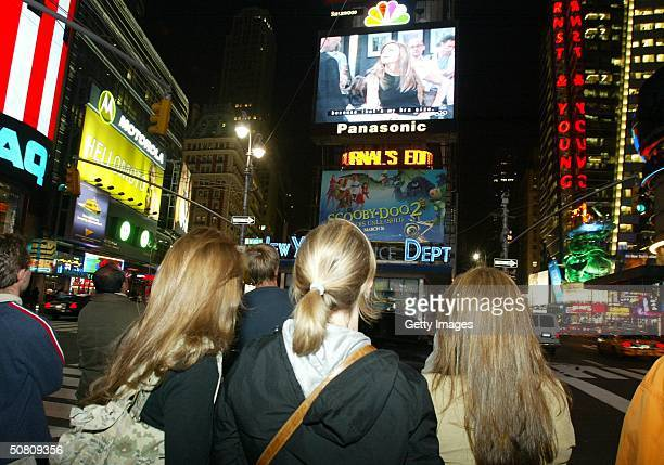 A crowd of New Yorkers watch the Friends finale being broadcast live on the Astrovision video screen in Times Square May 6 2004 in New York City