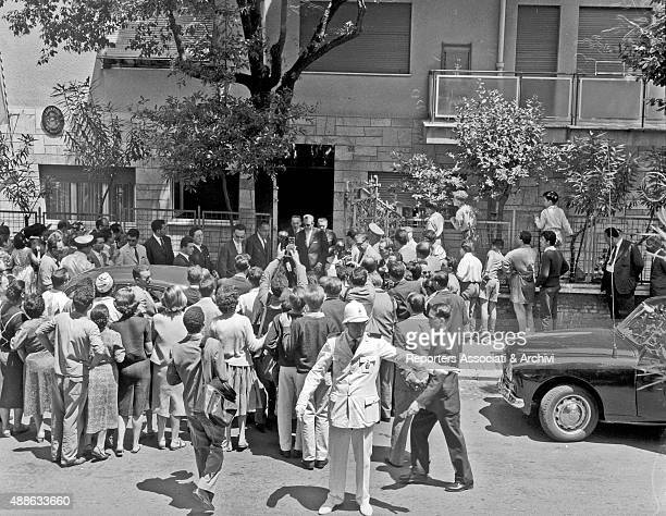 A crowd of onlookers and photographers in front of the embassy of Monaco waiting for Rainier III Prince of Monaco and his wife American actress and...