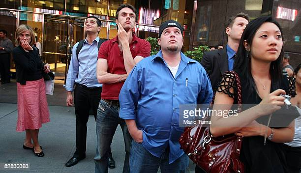 A crowd of onlookers gathers outside Lehman Brothers Holdings Inc headquarters September 15 2008 in New York City Lehman Brothers filed a Chapter 11...