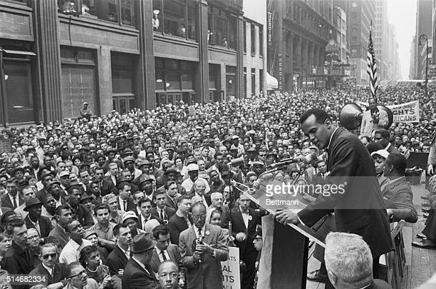 A crowd of over 10000 civil rights marchers gathers in the Manhattan Garment Center as Harry Belafonte sings at spiritual at a civil rights rally