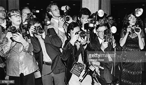 A crowd of paparazzi struggle to take photos of arriving musical celebrity at the annual Grammy Awards in Los Angeles California