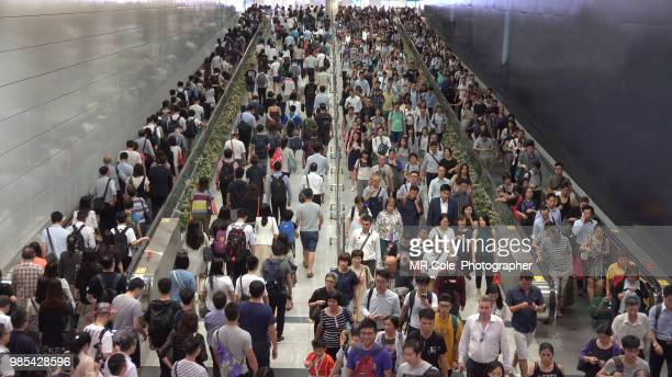 crowd of pedestrian commuters on train station,rush hour in hong kong - atestado fotografías e imágenes de stock