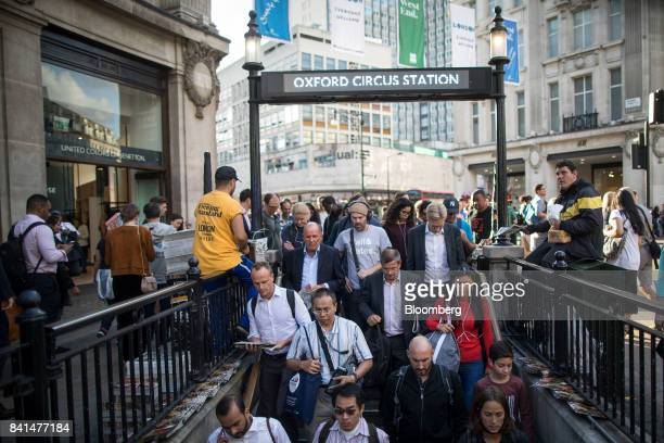 A crowd of pedestrians enter the stairs leading to London Underground metro station at Oxford Circus in central London UK on Thursday Aug 31 2017 UK...