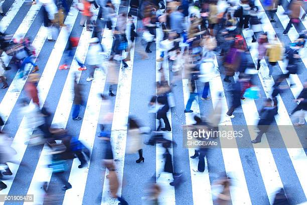 crowd of pedestrians walking - stampeding stock pictures, royalty-free photos & images