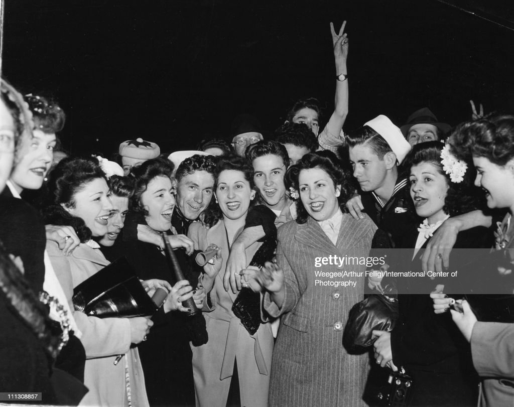 A crowd of people, among them at lease one sailors, celebrate VE Day (Victory in Europe Day), New York, New York, early May 1945. (Photo by Weegee(Arthur Fellig)/International Center of Photography/Getty Images)