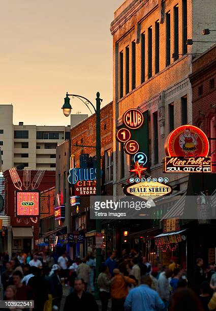 crowd of people and buildings on beale street in memphis - memphis stock photos and pictures