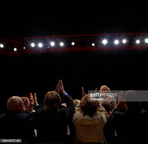 crowd of people applauding mature woman standing at front - applauding stock pictures, royalty-free photos & images