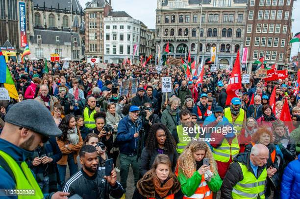 A crowd of people are seen listening to speeches at the Dam square during the demonstration Thousands of people gathered at the Dam square in the...