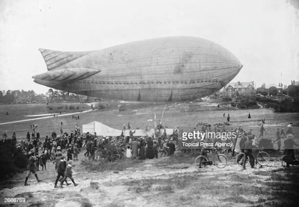 A crowd of people at Aldershot watching the British Army's new airship 'Baby' being demonstrated