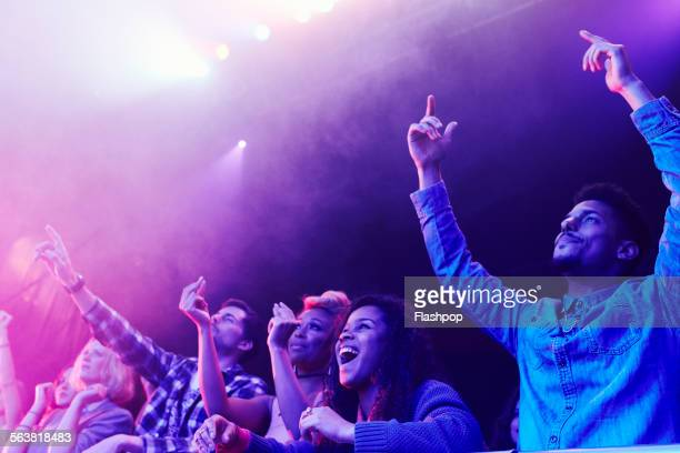 crowd of people at music concert - concert stock pictures, royalty-free photos & images