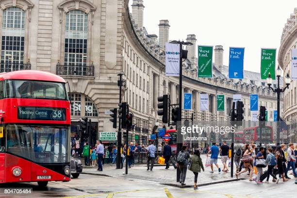crowd of people at piccadilly circus in london - west end london stock photos and pictures
