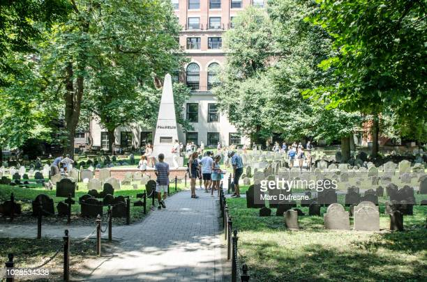 Crowd of people at the Boston Granary Burying Ground during summer day