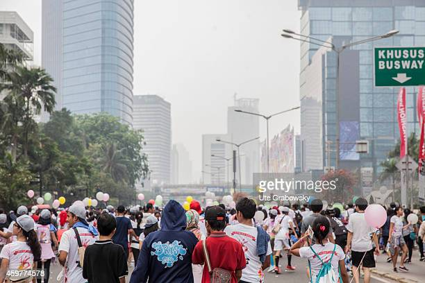 Crowd of people at the Bundaran HI square in the city center at a Car Free Sunday on November 02 in Jakarta Indonesia Photo by Ute...