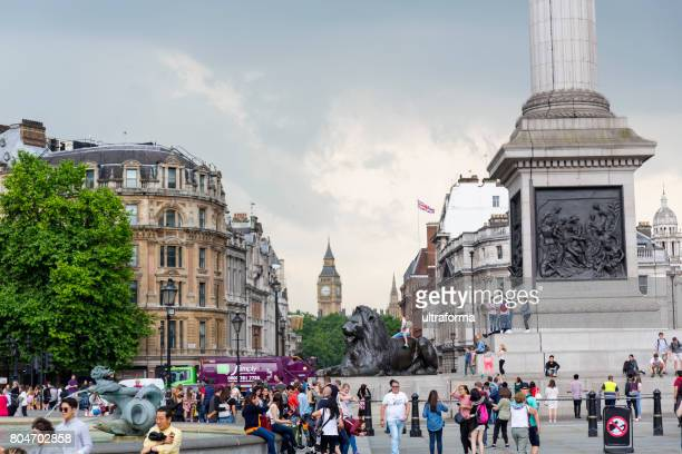 crowd of people at trafalgar square in london - west end london stock photos and pictures