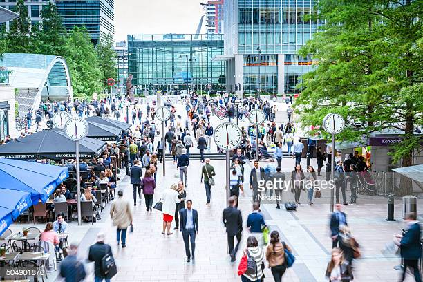 crowd of people , canary wharf in london, uk - canary wharf stock photos and pictures