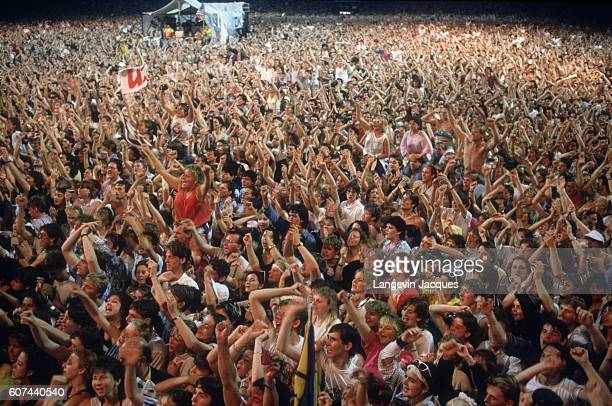A crowd of people cheer during the Live Aid concert held in London The 1985 concert was held simultaneously at JFK Stadium in Philadelphia and at...