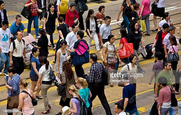 A crowd of people cross a street in the City Centre District on May 31 in Hong Kong China Viewed as one of the world's major trade centers with a...