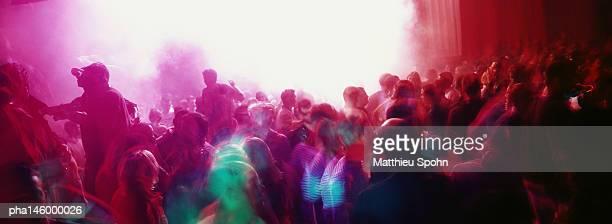 Crowd of people dancing at a nightclub