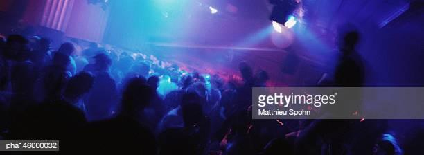 Crowd of people dancing at nightclub