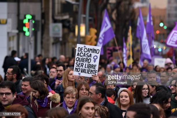 Crowd of people during the International Women's Day demonstration demanding for gender equality with and against women violence in Tarragona