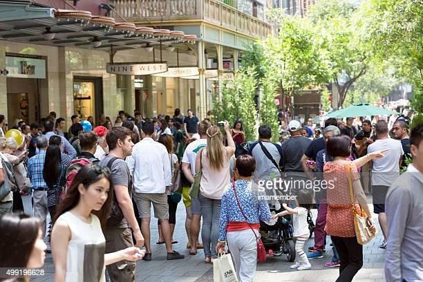 Crowd of people enjoying local musician performing on Pitt Street