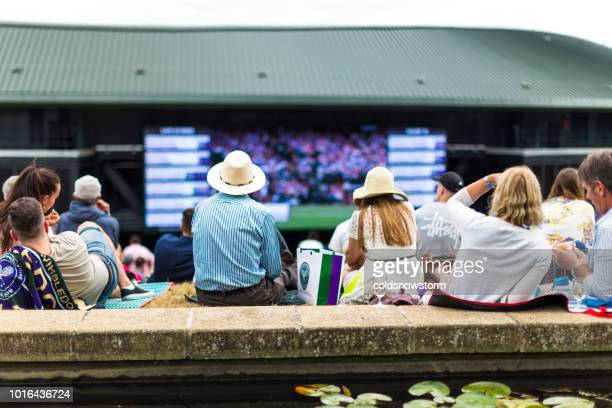 crowd of people enjoying tennis on the hill, wimbledon, uk - wimbledon stock pictures, royalty-free photos & images