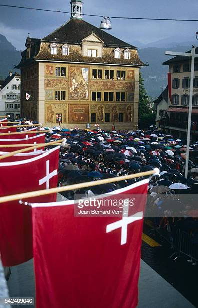 A crowd of people gather in Schwyz Switzerland to celebrate the 700th anniversary of the Swiss Confederation