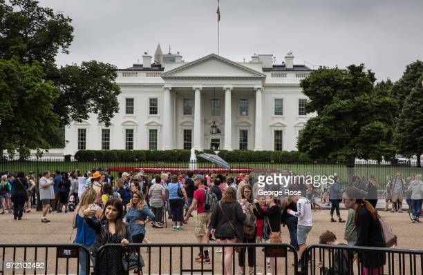 A crowd of people gather on the mall in front of the White House on June 4 2018 in Washington DC The nation's capital the sixth largest metropolitan...