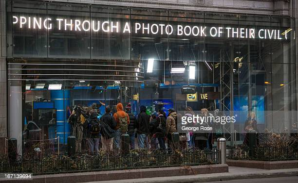 A crowd of people gather outside the local ABC TV broadcast station on March 26 in Chicago Illinois Visitors to The Windy City the third most...