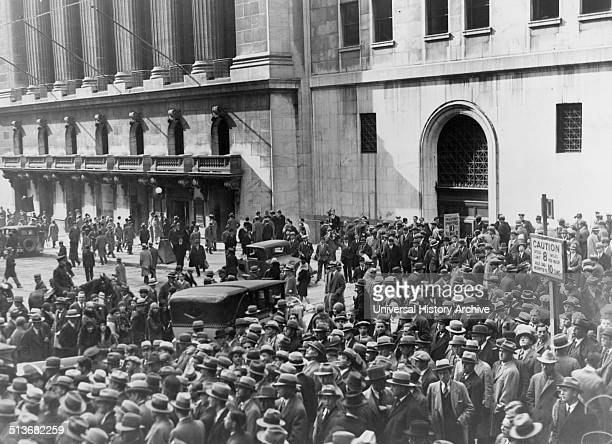 A crowd of people gather outside the New York Stock Exchange following the Crash of 1929 Also known as Black Tuesday it was the most devastating...