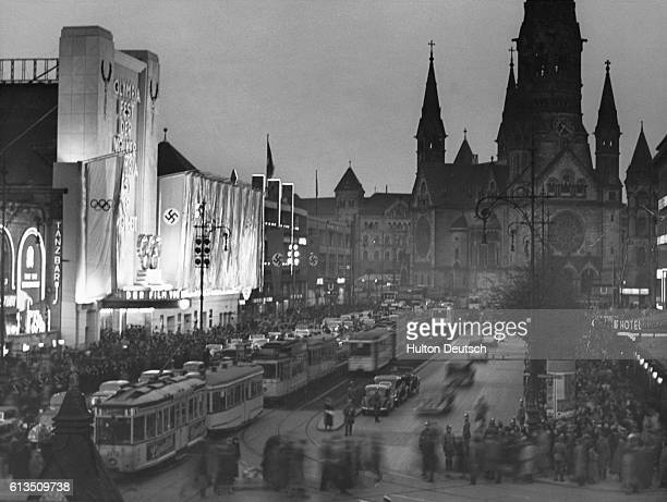 A crowd of people gather outside the UFLA Palace for the premiere of Leni Riefenstahl's film about the 1936 Berlin Olympics It is Adolf Hitler's 49th...