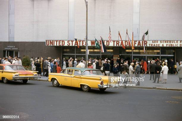 Crowd of people gathered in front of the New York Coliseum in Columbus Circle Manhattan during the World Trade Fair New York New York October 1 1963