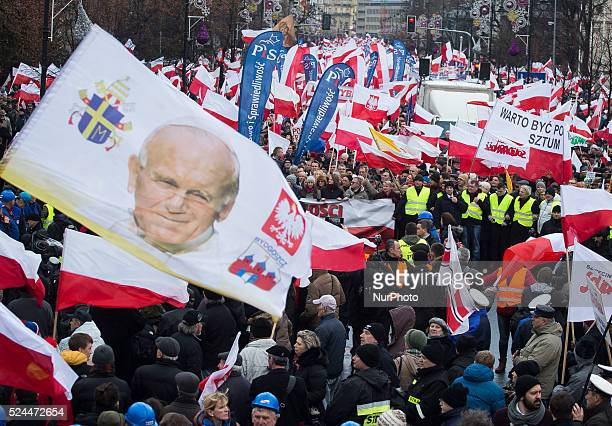 A crowd of people going on the march of freedom and solidarity organized by the ruling party Law and Justice in Warsaw 13 December Poland on the 34...