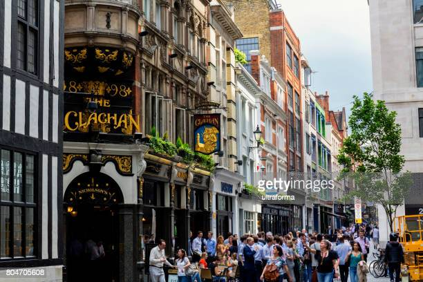 crowd of people in a pub on kingly street london - west end london stock pictures, royalty-free photos & images