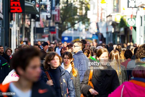crowd of people in cologne - tall person stock pictures, royalty-free photos & images