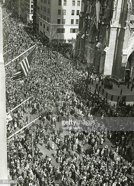 crowd of people in front of st. patrick's cathedral, nyc, (b&w), (high angle view) - st. patricks cathedral manhattan stock photos and pictures