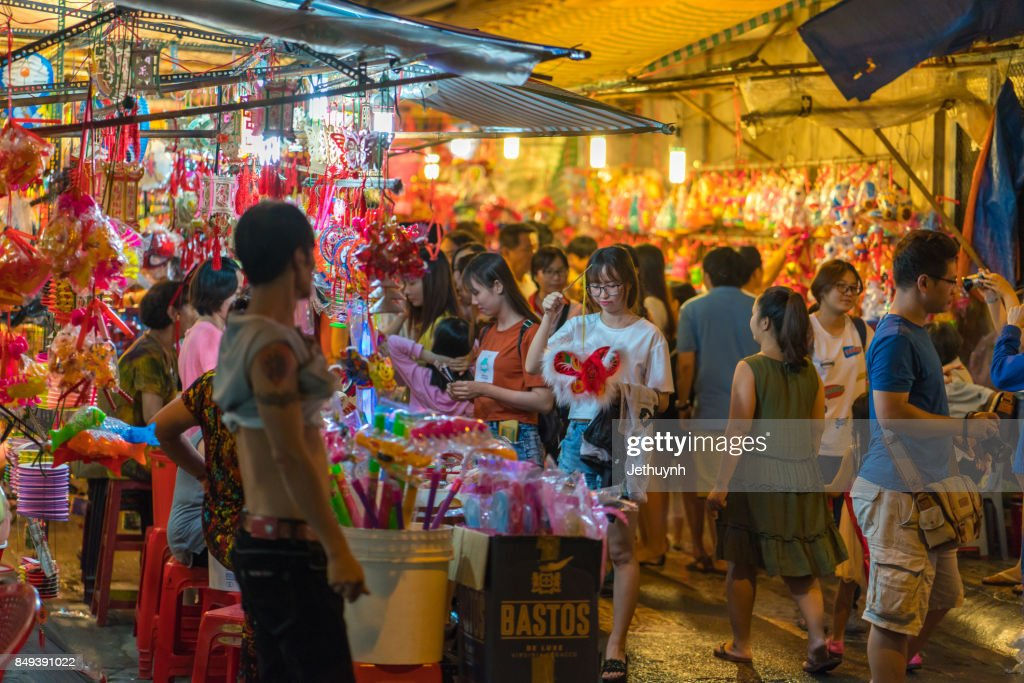 crowd of people in lanterns road are on sale at Luong Nhu Hoc Street, a famous street of lanterns : Stock Photo