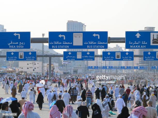 crowd of people in mecca - al haram mosque stock photos and pictures