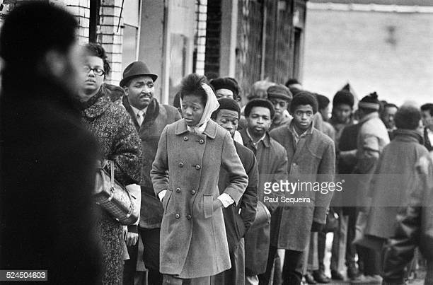 A crowd of people line up outside the Rayner Funeral Home to pay last respects to slain Black Panther Party leader Fred Hampton after he was killed...
