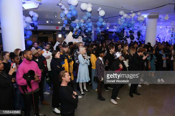 Crowd of people listen to a panel discussion at the Evian Virgil Abloh Collaboration party at Milk Studios on February 10 2020 in New York City