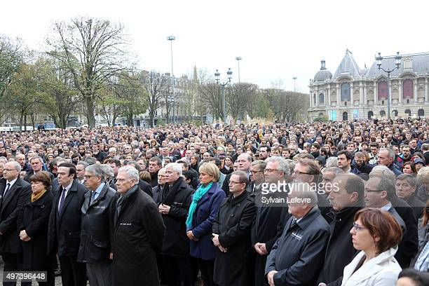 A crowd of people observe a minute of silence in tribute to the victims of the attacks in Paris on November 16 2015 in Lille France Countries across...
