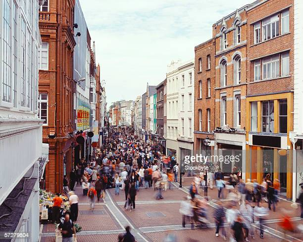 crowd of people on grafton street in dublin, ireland - dublin stock pictures, royalty-free photos & images