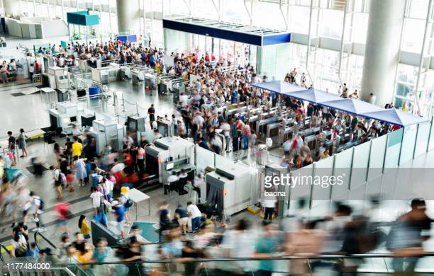 crowd of people on railroad station lobby - security stock pictures, royalty-free photos & images