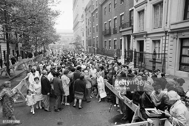 A crowd of people outside of Judy Garland's funeral services in New York City