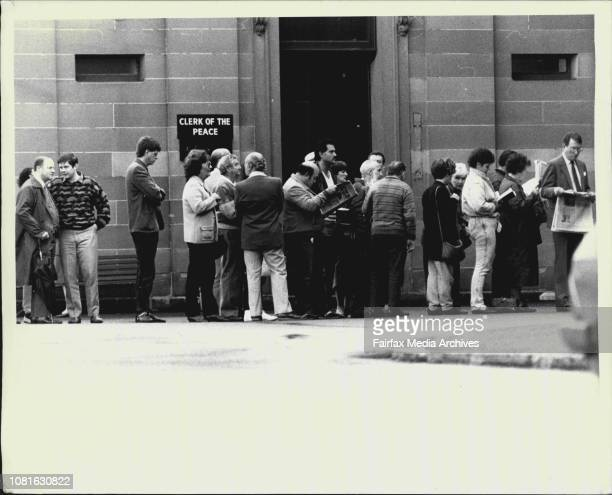 A crowd of people queuing to enter the court complex June 16 1987