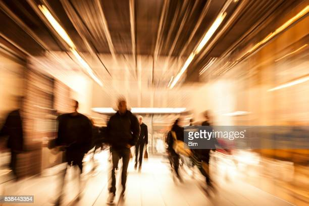 crowd of people rushing through corridor, zoom effect, motion blur - shop stock pictures, royalty-free photos & images