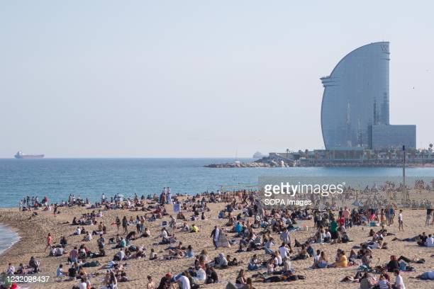 Crowd of people seen on the beach of Barceloneta. The Barceloneta Beach in Barcelona is already crowded. Due to the corona virus pandemic, Catalonia...