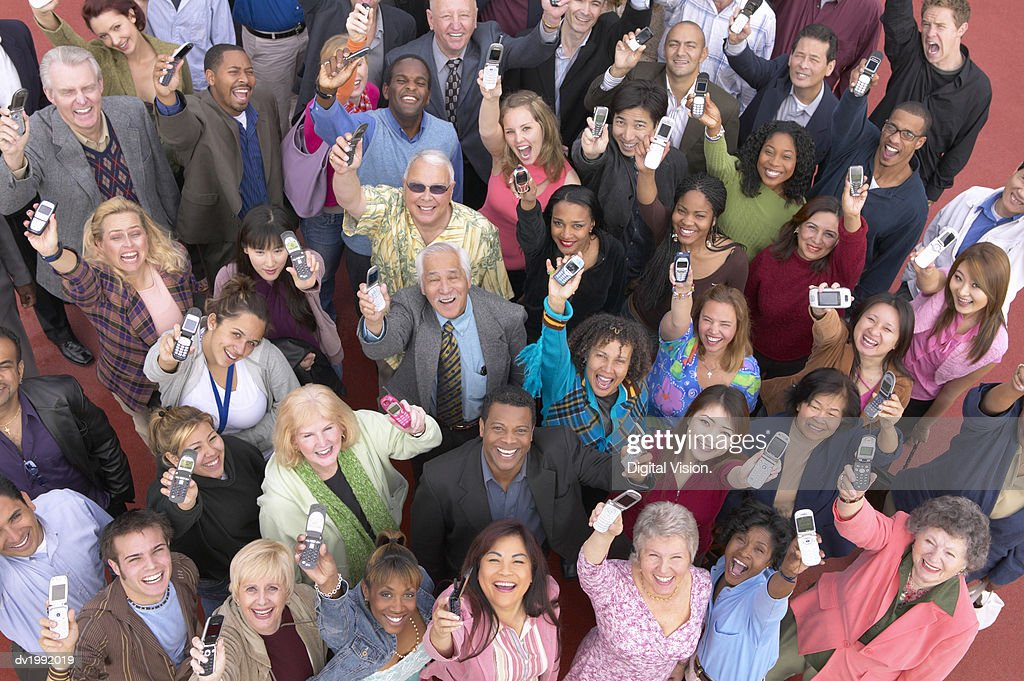 Crowd of People Showing Their Mobile Phones : Stock Photo